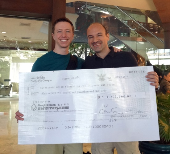 Holding the check with team member Marco Gorin in Bangkok, Thailand.